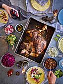 Lamb carnitas with sauces, salads and tortillas