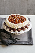 Meringue cake with profiteroles and glace chestnuts