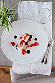 Squacquerone cream with strawberries and balsamic sauce
