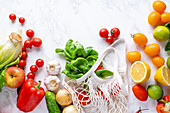 Healthy cooking ingredients - oranges, tomatoes, salad, basil and peppers