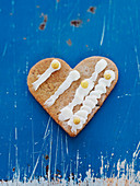 Heart-shaped cookie on blue background