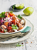 Vegetable salad with beans, carrots, cheese, chorizo, and lime dressing