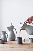 Coffee is poured into mug