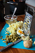 Grated potatoes with gherkins and eggs
