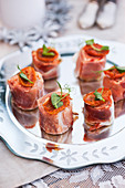 Parma ham rolls with dried tomatoes for Christmas
