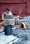 Winter picnic with cake and coffee