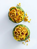 Courgette with a spicy bulgur filling and onion rings
