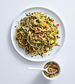 Spaghetti with avocado, shallots and cherry tomatoes