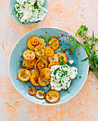 Fried potatoes with chili and herb quark dip