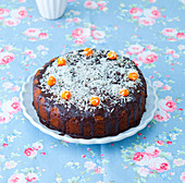 Carrot cake with chocolate icing and grated coconut