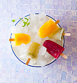 Orange, raspberry and lime-mint ice lollies