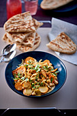 Vegetarian chickpea curry with naan bread