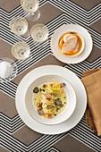 Spaghetti with a creamy leek sauce, hazelnuts and black truffles