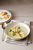 Potato, celery and cream cheese soup with Castelmagno bread chips
