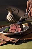 Sliced goat meat in wine sauce (chamois roast, Austria)