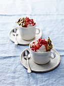 Mascarpone ice cream with pomegranate sauce and pumpkin seed crisps