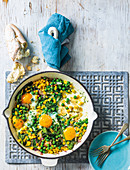 Pea, spinach and corn skillet eggs