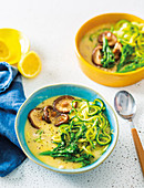 Summer chicken soup with mushrooms and zucchini