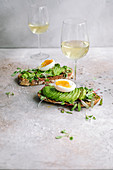 Avocado toasts with white wine