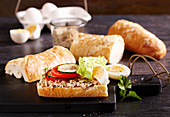 Baguette with tuna niscoise salad, tomato, cucumber, mayonnaise, eggs, mustard and lettuce leaf