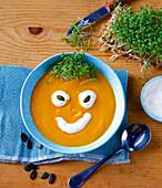 Halloween soup made from pumpkin, apple and leek