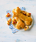 Pastry bones with cheese and salami