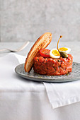 Beef tartare with quail's eggs and caper fruits