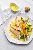 Sole in champagne and saffron sauce with vegetables