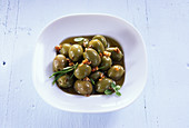 Pickled green olives with garlic and herbs