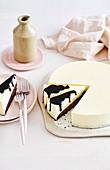 White chocolate mousse cake with dark chocolate sauce