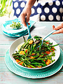 Summer salad with beans, green asparagus and cherry tomatoes