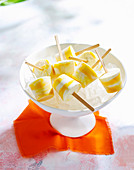 Popsicles with mango and greek yogurt