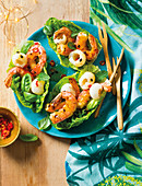 Litchi and prawn lettuce cups with passion fruit dressing