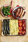 Italian flag made of roasted vegetables, served with sausages