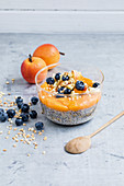 Chia and apricot pudding made from almond drink