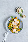 Roast chicken breast with a pumpkin and lentil curry