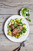 Beef steaks with avocado and cucumber salsa