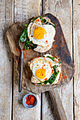 Wholemeal bread topped with fried egg and spinach