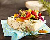 Flatbread with mozzarella, grilled vegetables, fresh herbs and olive oil