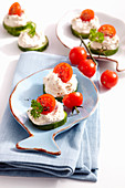 Tuna cream on cucumber slices with cherry tomatoes
