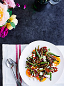 Heirloom tomato salad with feta, pistachio pesto and fried okra