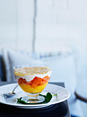 Tropical fruit cup with coconut cream and finger lime jelly