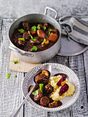 Boeuf bourguignon on mashed potatoes and parsnips