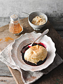 Alcoholic Dampfnudeln (steamed, sweet yeast dumpling) with elderberry sauce and pear compote