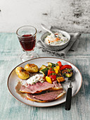 Grilled leg of lamb with grilled vegetables and roast potatoes