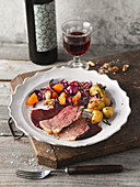 Roast lamb with a red cabbage and orange salad