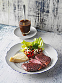 Roast beef with yeast dumplings and a lentil salad
