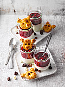 Sour cream with a berry topping and 'pig biscuits'