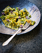 Pumpkin, goat's cheese and sun-dried tomato ravioli with pickled celery and salsa verde