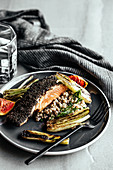 Liquorice and black garlic crusted salmon with buckwheat salad